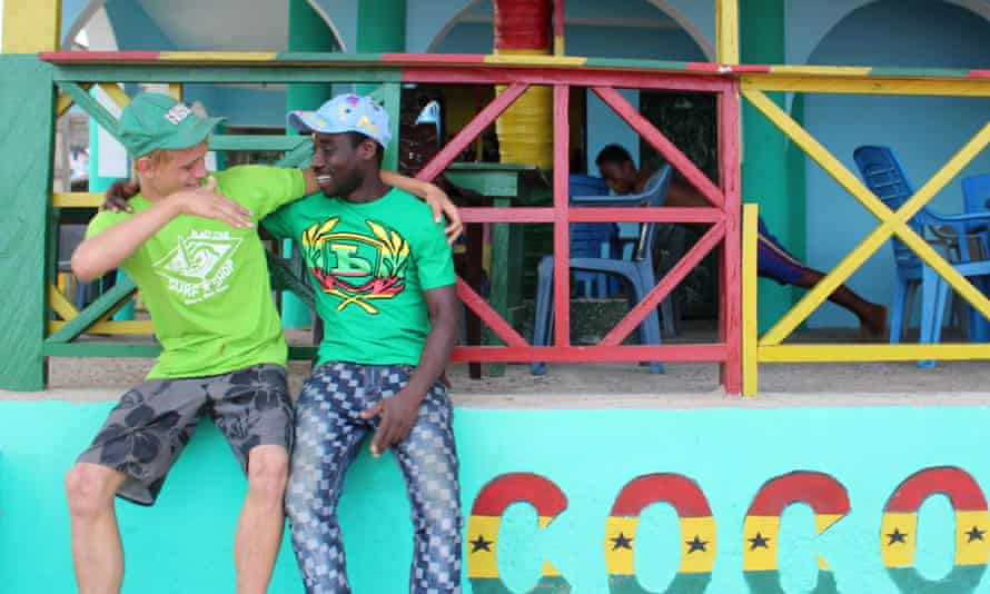 Ben Dewar (left) with the owner of the Coconut Dreams bar on Busua beach.