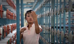 A North Korean woman works at the Kim Jong-suk textile factory on 31 July, 2014, in Pyongyang, North Korea. This is the country's largest textile factory with 8,500 workers, where 80% of them are women.(AP Photo/Wong Maye-E)