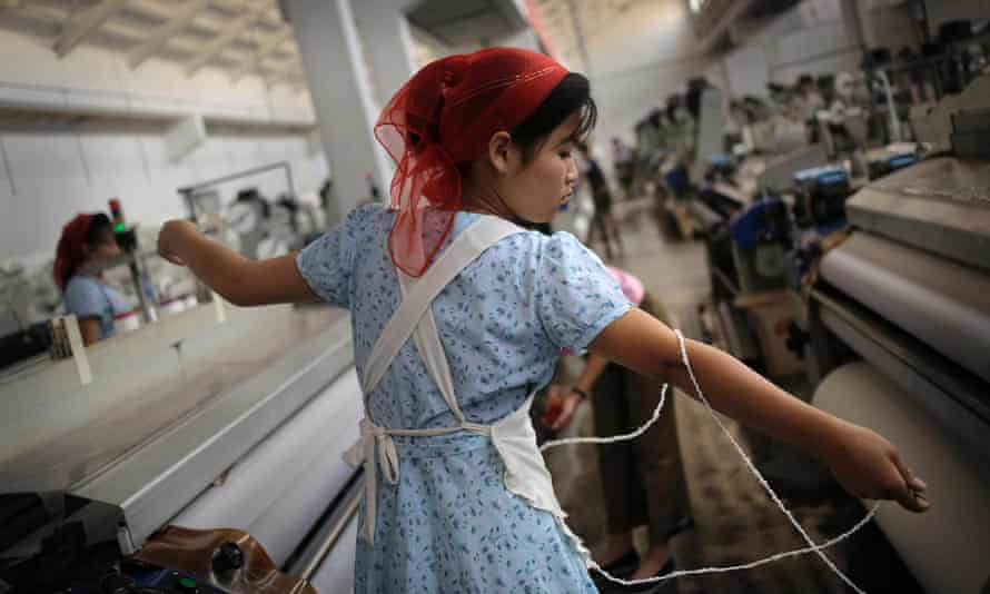 A North Korean woman stretches out a string of yarn at the Kim Jong-Suk textile factory.