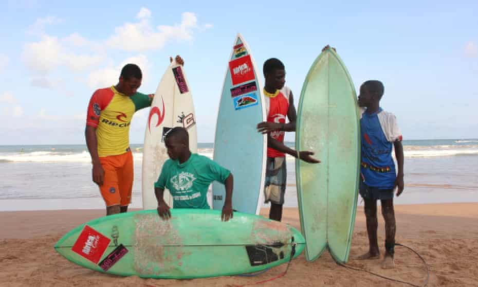 Local surfers - taught to ride by Black Star Surf School and Mr Brights - pose on the beach before the competition.