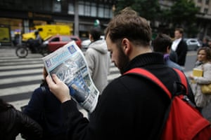 """A man reads a newspaper with a headline that reads in Spanish; """"Argentina didn't accept the conditions of the vultures,"""" in reference to the dispute of Argentina over $1.5 billion with a U.S. hedge fund, known locally as """"vulture funds,"""" in Buenos Aires, Argentina, Thursday, July 31, 2014."""
