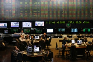 Brokers work at the Buenos Aires Stock Exchange in Buenos Aires, Argentina, Thursday, July 31, 2014.