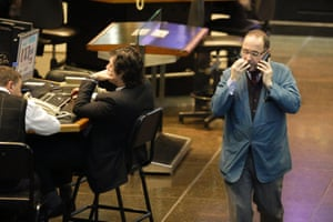 Brokers work at the Buenos Aires Stock Exchange in Buenos Aires, Argentina, Thursday, July 31, 2014. The collapse of talks with U.S. creditors sent