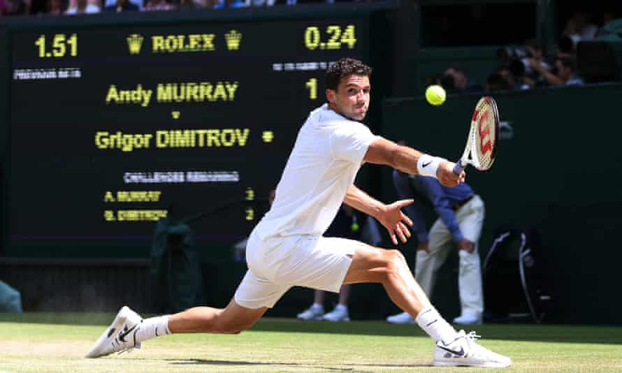 """""""Dimitrov, he's one to watch,"""" says one of the data entry team as he watches the Bulgarian compete against Britain's Andy Murray in the mens quarter-final of the Wimbledon championships"""