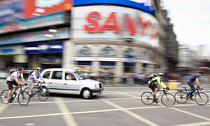 Cyclists in Piccadilly Circus, London