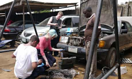 Kayleigh Robertson in Nigeria working as a mechanic