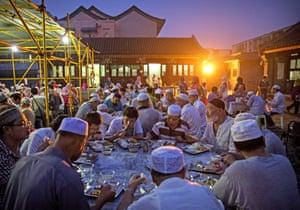Chinese Muslims eat at dusk during Ramadan at the historic Niujie Mosque in Beijing, China