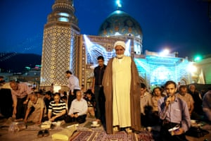 An Iranian clergyman prays in northern Tehran, Iran