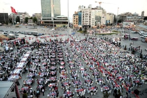 Nearly 3 thousand Muslims eat at a fast-breaking dinner in Taksim Square, Istanbul, Turkey