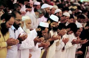 Pakistani devotees offer Friday prayers in Karachi, Pakistan