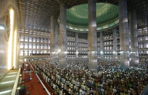 Muslims offer Friday prayers at Istiqlal Mosque in Jakarta, Indonesia