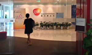 A Chinese employee walks into a GSK office