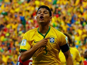 Brazil's Thiago Silva celebrates after scoring against Colombia.