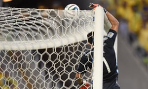 Colombia's goalkeeper David Ospina tips the ball over as Brazil exert more pressure on his goal.