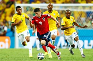 Maicon, Fernandinho  and Paulinho try and keep up with James Rodriguez.