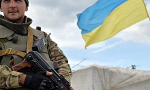 A Ukrainian forces serviceman guards the