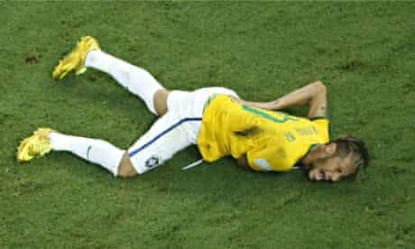 Brazil's forward Neymar rolls in agony after his collision with Colombia's Zuniga
