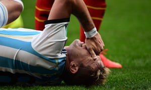 Argentina's midfielder Lucas Biglia falls in agony after a foul by Eden Hazard.