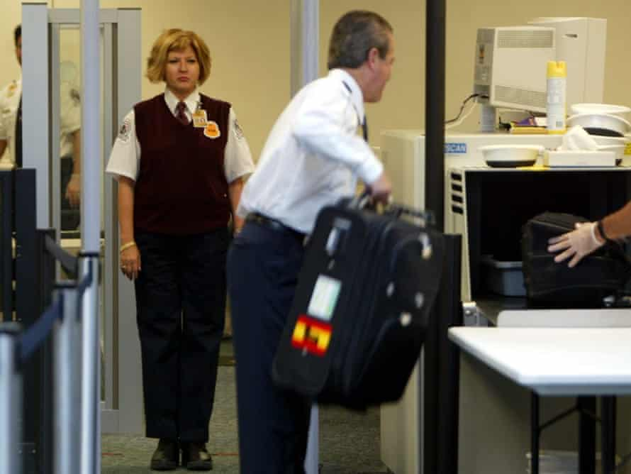 Transportation Security Administration screeners check passengers as they prepare to board flights. tsa