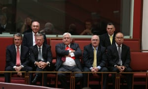 Warren Truss, PUP leader Clive Palmer and assorted MPs watch the swearing in ceremony.