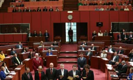 PUP Senator Ricky Muir joins fellow Victorians to be sworn in as the public galleries watch on.