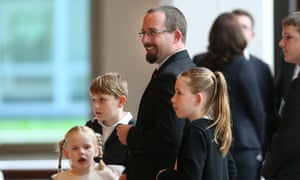 Australian Motoring Enthusiast Party senator Ricky Muir with his family after being sworn in as a senator in Parliament House.