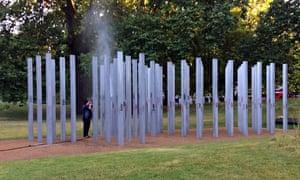 Hyde Park staff clean graffiti off the 7/7 memorial
