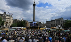 Crowds in Trafalgar Square gather to watch stage three of the Tour de France.