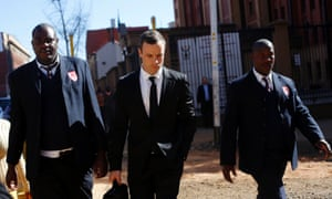 Oscar Pistorius, centre, leaves court escorted by two private security officers in Pretoria, on Monday 7 July, 2014.