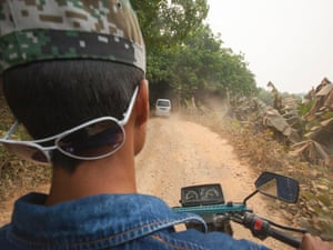 A motorcycle smuggles a passenger from China to Burma through rubber plantations and jungle, avoiding the official Chinese border crossing, outside MongLa, Shan State Special Region Four, Burma, 04 April 2014.
