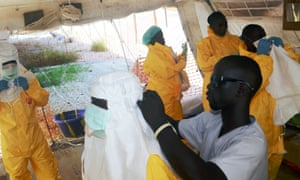 Members of work in an isolation ward in a hospital in Conakry, where people infected with the Ebola virus are being treated