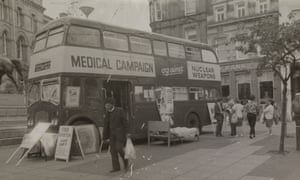 Medical Campaign Against Nuclear Weapons double decker bus in Birmingham, Chamberlain Square, 1980s.
