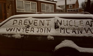 Archive photograph of Medical Campaign Against Nuclear Weapons protest writing in snow on side of car. 1980s.