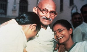 Mahatma Ghandi with his two granddaughters Ava and Manu