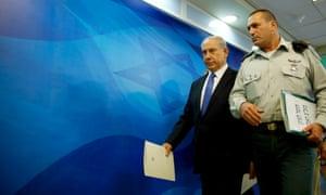 Israeli Prime Minister Benjamin Netanyahu, arrives to chair the weekly cabinet meeting in his office in Jerusalem.