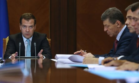 Russia's Prime Minister Dmitry Medvedev (L) chairs a meeting on Crimea at the Gorki state residence outside Moscow, on 8 July, 2014. Photograph: RIA Novosti/Reuters