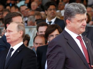 Ukraine's President (then President-elect) Petro Poroshenko, right, walks past Vladimir Putin during the commemoration of the 70th anniversary of D-Day in France, on 6 June, 2014. Photograph: Christophe Ena/AP