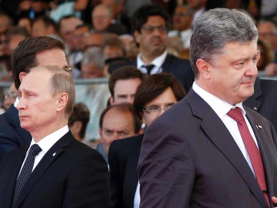 Ukraine's President (then President-elect) Petro Poroshenko, right, walks past Vladimir Putin during the commemoration of the 70th anniversary of D-Day in France, on 6 June, 2014. Photograph: Christophe Ena/AP