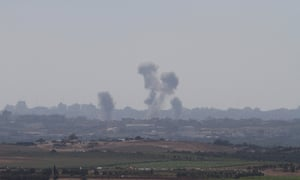 Nir Am, Israel - Smoke is rising over the northern Gaza Strip after an attack of Israeli airplanes.