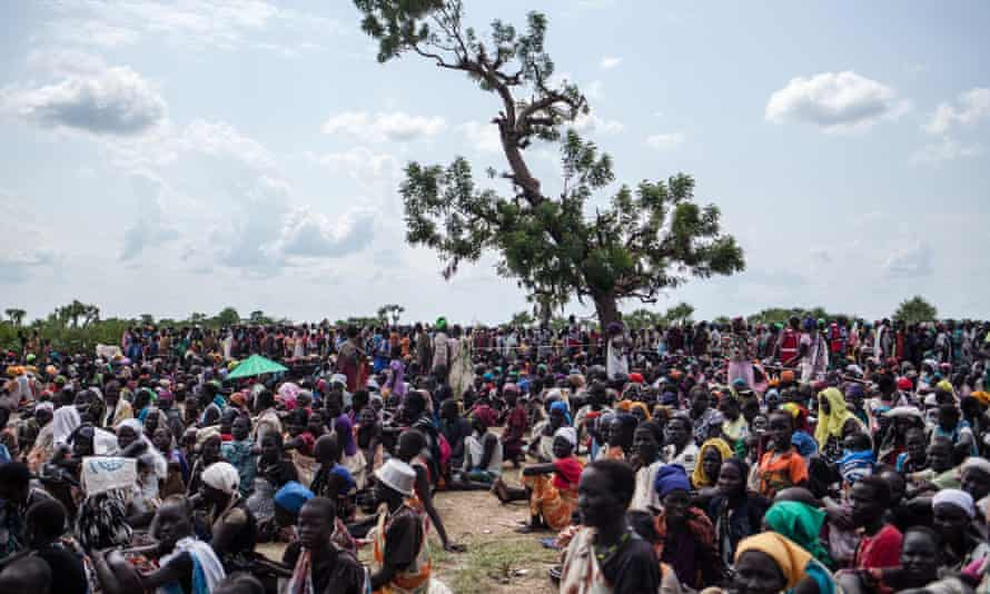 Thousands of people wait in the hot sun near the air drop zone in Leer, South Sudan, on July 5, 2014.