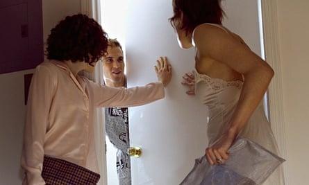 Women waiting at bathroom door