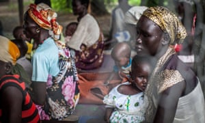 Families with malnourished children wait to receive treatment at the Leer Hospital, South Sudan, on July 7, 2014.
