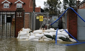Sandbags protect a an electricity sub-station as flooding continues in Staines, west of London on February 12, 2014.