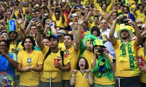 Brazilian fans, including a rather enthusiastic youngster, cheer on their boys.