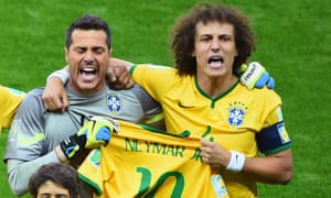 Goalkeeper Julio Cesar and David Luiz sing the National Anthem with gusto whilst clutching a Neymar shirt.