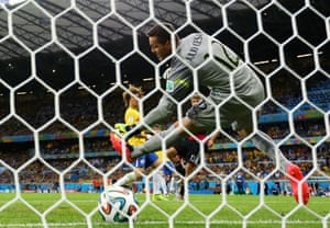 The ball flies past Julio Cesar to give Germany the lead.