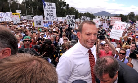 Opposition leader Tony Abbott leaving an anti-carbon tax rally in Canberra in 2011