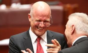 LDP Senator David Leyonhjelm is congratulated by Senator Doug Cameron.