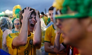 A Brazil soccer fan reacts in frustration as he watches his team play a World Cup semi-final match against Germany