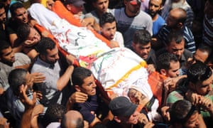 Palestinians carry the body of senior local leader of the Islamic Jihad militant group Hafez Hamad during his funeral in the town of Beit Hanoun in the northern Gaza Strip.